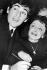 Edith Piaf (1915-1963), chanteuse française, et Théo Sarapo (1936-1970), chanteur français d'origine grecque, signant le registre de mariage. Paris, 11 octobre 1962. © TopFoto/Roger-Viollet