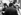 """Rita Hayworth (1918-1987) et Claudia Cardinale (née en 1938), sur le tournage du """"Plus grand cirque du monde"""" (Circus World), film de Henry Hathaway. Madrid (Espagne), 13 janvier 1964. © TopFoto / Roger-Viollet"""