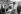 Coiffeur dans le bidonville de la communauté portugaise. Champigny-sur-Marne (Val-de-Marne), 1964. © Georges Azenstarck / Roger-Viollet