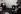 Affaire du Watergate. Carl Bernstein (né en 1944, assis sur une chaise) et Bob Woodward (né en 1943), journalistes américains, regardant un discours télévisé de Richard Nixon (1913-1994), homme d'Etat américain. Washington D.C. (Etats-Unis), 30 avril 1973. Photo : Mark Godfrey. © Mark Godfrey/The Image Works/Roger-Viollet