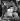 Pablo Picasso (1881-1973), peintre et sculpteur espagnol, de dos, à gauche, dans son atelier, rue des Grands-Augustins (VIème arr.). Paris, novembre 1944. © Pierre Jahan / Roger-Viollet