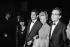 """Agnès Varda et Jacques Demy, réalisateurs français, Michel Legrand, compositeur français, et Christine Bouchard, sa première épouse, lors du 17ème festival de Cannes lorsqu'ils remportent la Palme d'Or pour """"Les Parapluies de Cherbourg"""". Cannes, mai 1964. © Noa / Roger-Viollet"""