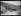 """Guerre d'Espagne (1939-1936). """"La Retirada"""". L'arrivée en France des derniers réfugiés espagnols par le col d'Arès. Un panneau invite ceux qui veulent retourner en Espagne nationaliste à se ranger sur le bord de la route. Les autres continuent leur chemin vers Prats-de-Mollo-la-Preste et le camp de Saint-Cyprien. 14 février 1939. Photographie Excelsior. © Excelsior - L'Equipe / Roger-Viollet"""