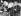 A la suite d'une vague de chaleur, des écoliers participent à un cours en plein air coiffés d'un chapeau en papier pour se protéger du soleil. 1935.    © Imagno/Roger-Viollet