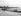 Le pont du Crouton avec la vue sur l'Eden-Roc et le Grand Hôtel du Cap. Le Cap-d'Antibes (Alpes-Maritimes), vers 1900. © Neurdein/Roger-Viollet