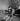 Couple s'embrassant au bord de la Seine. Paris, novembre 1976. © Roger-Viollet