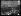 """Guerre 1914-1918. Les troupes américaines à Paris, le 3 juillet 1917. Acclamé par la foule, le 2ème bataillon du 16ème d'infanterie américain sort de la gare d'Austerlitz. Photographie parue dans le journal """"Excelsior"""" du mercredi 4 juillet 1917. © Excelsior – L'Equipe/Roger-Viollet"""