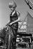 """Catherine Deneuve (née en 1943), actrice française, pendant le tournage des """"Demoiselles de Rochefort"""", film de Jacques Dem. France, 1966. Photographie de Georges Kelaïditès (1932-2015). © Georges Kelaïditès / Roger-Viollet"""