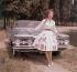 Femme devant une automobile Olsmobile. France, 1959. © Roger-Viollet
