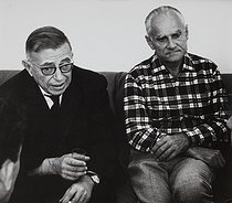 """Jean-Paul Sartre and Alberto Moravia at the Venice Film Festival for the presentation of the film """"Le mur"""" after Jean-Paul Sartre's book. Venice (Italy), 1967. Photograph by Janine Niepce (1921-2007). © Janine Niepce / Roger-Viollet"""