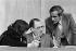 Pierre Bérégovoy (1925-1993), ancien maire de Nevers et Premier ministre de François Mitterrand de 1991 à 1993. Debout : Paul Quilès (né en 1942), homme politique français. © Jacques Cuinières / Roger-Viollet