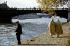 Raymond Duncan (1874-1966), American philosopher and artist, on the quays of the river Seine, in front of the Solférino footbridge (present Léopold-Sédar-Senghor footbridge). Paris (VIIth arrondissement), 1960-1970. Photograph by Gösta Wilander (1896-1982). Paris, musée Carnavalet. © Gösta Wilander/Musée Carnavalet/Roger-Viollet
