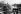 Ouvriers portugais mangeant sur un chantier. Bobigny (Seine-Saint-Denis), janvier 1971. Photographie de Léon Claude Vénézia (1941-2013). © Léon Claude Vénézia / Roger-Viollet