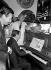 Maurice Biraud (1922-1982), acteur français, Eddie Barclay (1921-2005), producteur de musique français, et Charles Aznavour (1924-2018), auteur-compositeur-interprète et acteur français d'origine arménienne. © Noa / Roger-Viollet