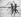 """Jeunes femmes dansant avec des foulards sur une plage, 29 août 1936. Photographie de Heinrich Hoffmann (1885-1957), publiée dans le journal """"B.Z."""". © Heinrich Hoffmann/Ullstein Bild/Roger-Viollet"""