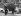 Deux enfants rapportant un sapin de Noël chez eux. Paris, 13 décembre 1961. © TopFoto/Roger-Viollet