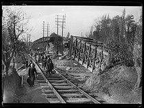 "World War One. Civilians crossing a dynamited railway bridge near the recaptured city of Lille (France), late October 1918. Photograph published in the newspaper ""Excelsior"" on October 31, 1918. © Excelsior – L'Equipe/Roger-Viollet"