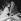 """Jean-Louis Trintignant et Dany Carrel pendant le tournage du film """"Club de femmes"""" de Ralph Habib. France, 1956.  © Alain Adler / Roger-Viollet"""