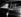 John Foster Dulles (1888-1959), secrétaire d'Etat américain, en voiture avec l'ambassadeur des Etats-Unis en France Douglas Dillon. Paris, 26 octobre 1955. © Roger-Viollet