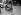 Guerre 1939-1945. Chien traînant une voiture de lait. Paris, 1941. © LAPI/Roger-Viollet