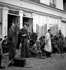 """Tournage du film """"Madame Bovary"""" de Jean Renoir (au centre). A droite, avec un imperméable blanc : Claude Renoir, chef opérateur.   © Boris Lipnitzki / Roger-Viollet"""