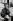 """Simone de Beauvoir. """"Le Deuxième Sexe"""" de Simone de Beauvoir, publié en 1949, marque une étape importante dans l'histoire de l'émancipation des femmes. Boulevard Raspail. Paris (VIème arr.), 1978. Photographie de Janine Niepce (1921-2007). © Janine Niepce / Roger-Viollet"""