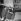 Jules Dassin (1911-2008), acteur et cinéaste américain, Carl Möhner (1921-2005), acteur, réalisateur, scénariste et peintre autrichien, et Melina Mercouri (1920-1994), actrice et femme politique grecque, 6 avril 1957. © Alain Adler / Roger-Viollet