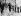Madame Jackie Kennedy et ses deux enfants John et Caroline, quittant le Capitole, où repose le corps de son mari, le président John Fitzgerald Kennedy. Washington, 26 novembre 1963. © TopFoto / Roger-Viollet