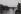 """Promenade dans Paris. Photographies destinées à illustrer les livres d'Aragon """"Le Paysan de Paris"""" et """"Il ne m'est Paris que d'Elsa"""". Le pont des Arts au crépuscule. Vue prise vers l'est."""" Qui fauche à tort ton coeur d'un cri de remorqueur ébloui. """". 1953. Photographie de Jean Marquis (né en 1926). Bibliothèque historique de la Ville de Paris. © Jean Marquis/BHVP/Roger-Viollet"""