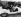 Prince Philip (né en 1921), duc d'Edimbourg, assis au siège passager de la Jaguar XKSS sports 3,5 litres pendant sa visite au siège de la Motor Industry Research Association, institut de recherche dans le secteur automobile près de Nuneaton (Angleterre), 3 avril 1957. © PA Archive / Roger-Viollet