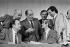 Meeting du Parti socialiste. De gauche à droite : André Labarrère (assis), Claude Estier, François Mitterrand, Laurent Cathala, Paul Quilès et Jacques Attali. Alfortville (Val-de-Marne), janvier 1980. © Jacques Cuinières/Roger-Viollet