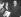 Golda Meir, ministre israélien des Affaires étrangères, répondant aux questions des journalistes après sa rencontre avec Guy Mollet (à droite), président du Conseil français. 16 mars 1957.     © Roger-Viollet