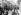 Accueil officiel d'ouvriers italiens émigrés à leur arrivée à Puteaux (Hauts-de-Seine), vers 1920. © Albert Harlingue / Roger-Viollet