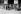 Guerre 1939-1945. Départ de Vichy du 152ème R.I. Le régiment va défiler devant le maréchal Pétain et l'amiral Darlan. En haut à droite, le général Revers, chef du cabinet militaire de Darlan. © Roger-Viollet