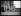 """Hommage des athlètes français aux morts de la guerre 1914-1918. Départ de flambeaux vers les cimetières du front. Les athlètes (de gauche à droite) : Prudent Joye (1913-1980), Roger Rochard (1913-1993), Jean-François Brisson (1918-2010), René Lécuron (1909-1985) et Jacques Lévêque (1917-2013), tenant leurs flambeaux, à l'Arc de Triomphe. Paris (VIIIe arr.), 11 novembre 1938. Photographie du journal """"Excelsior"""". © Excelsior - L'Equipe / Roger-Viollet"""
