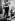 Luis Buñuel (1900-1983), scénariste et réalisateur d'origine espagnole et naturalisé mexicain, avec le vicomte de Noailles (gauche) et le compositeur français Georges Auric. 1930. © Ullstein Bild / Roger-Viollet