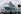 """Le paquebot de croisière """"Queen Mary 2"""". Préparation pour son départ à destination de Fort Lauderdale en Floride. Port de Southampton (Angleterre), 26 décembre 2003.  © Barry Batchelor / TopFoto / Roger-Viollet"""