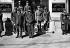 Le maréchal Pétain assistant au défilé du 152ème R.I. avant qu'il ne quitte Vichy. 1942. A sa gauche : l'amiral Darlan; à droite, sur les marches : le général Revers, chef du cabinet militaire de Darlan. © Albert Harlingue/Roger-Viollet