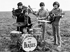 "Les Beatles. John Lennon, Ringo Star, Paul McCartney et George Harrison, lors du tournage de ""Help"". Salisbury (Angleterre), 3 mai 1965. © PA Archive/Roger-Viollet"