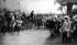 """Albert Dawant (1852-1923). """"La Revue de Bétheny (Marne), 21 septembre 1901"""" (le tsar Nicolas II, debout au centre, et la tsarine descendant de voiture, sont accueillis par le président Emile Loubet pour la revue des troupes). Salon de 1905. © Neurdein / Roger-Viollet"""