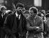Gerry Adams (né en 1948), Président du Sinn Féin, et Martin McGuinness (1950-2017), homme politique nord-irlandais, lors des funérailles de Patrick Kelly (1957-1987), activiste de l'Armée républicaine irlandaise (IRA, Irish Republican Army). Irlande du Nord, 11 mai 1987. © PA Archive / Roger-Viollet