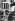 Petit garçon se rafraichissant avec un véhicule de nettoyage pendant une vague de chaleur, vers 1935. © Imagno/Roger-Viollet