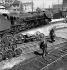 Workers at the engine depot of the SNCF (French National Railway Corporation). Paris, Porte de la Chapelle, 1956. Photograph by Janine Niepce (1921-2007). © Janine Niepce / Roger-Viollet
