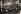 Photographie de groupe avec un instrument de musique traditionnel. © Archives Manouchian / Roger-Viollet
