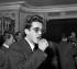 Michel Legrand (1932-2019), musicien, compositeur, pianiste de jazz et chanteur français, lors de la réception en l'honneur de Maurice Chevalier (1888-1972), acteur et chanteur français, 1959. © Roger-Viollet