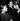 """Romy Schneider (1938-1982), actrice autrichienne, Alain Delon (né en 1935), acteur français, Jane Birkin (née en 1946), actrice et chanteuse anglaise, et Maurice Ronet (1927-1983), lors de l'avant-première de """"La Piscine"""", film de Jacques Deray. Paris, 30 novembre 1968. © TopFoto / Roger-Viollet"""