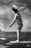 Enfant à la plage, carte postale fantaisie. France, vers 1910. © Roger-Viollet