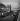 Tugboat and barges moored at the quai de Gesvres, near the Ile de la Cité. View of the Tour de l'Horloge and the pont au Change. Paris (Ist arrondissement), 1936. Photograph by Roger Schall (1904-1995). © Roger Schall/Roger-Viollet