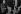 """Jean Renoir (1894-1979), cinéaste français, sur le tournage de """"French Cancan"""" avec des figurants. Paris, 1954. Photographie de Jean Marquis (né en 1926). © Jean Marquis / Roger-Viollet"""