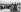Paris, Exposition universelle de 1900. Le président Emile Loubet, les personnalités du gouvernement et les ambassadeurs, le jour de l'inauguration, au pont Alexandre-III. 14 avril 1900. Dessin de Charles Morel (1861-1908). © Roger-Viollet